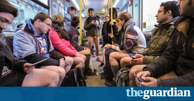 Travellers cast off inhibitions on no pants subway ride day inpictures
